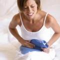 Болит ли при месячных живот?