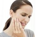 Киста зуба: причины, симптомы, лечение